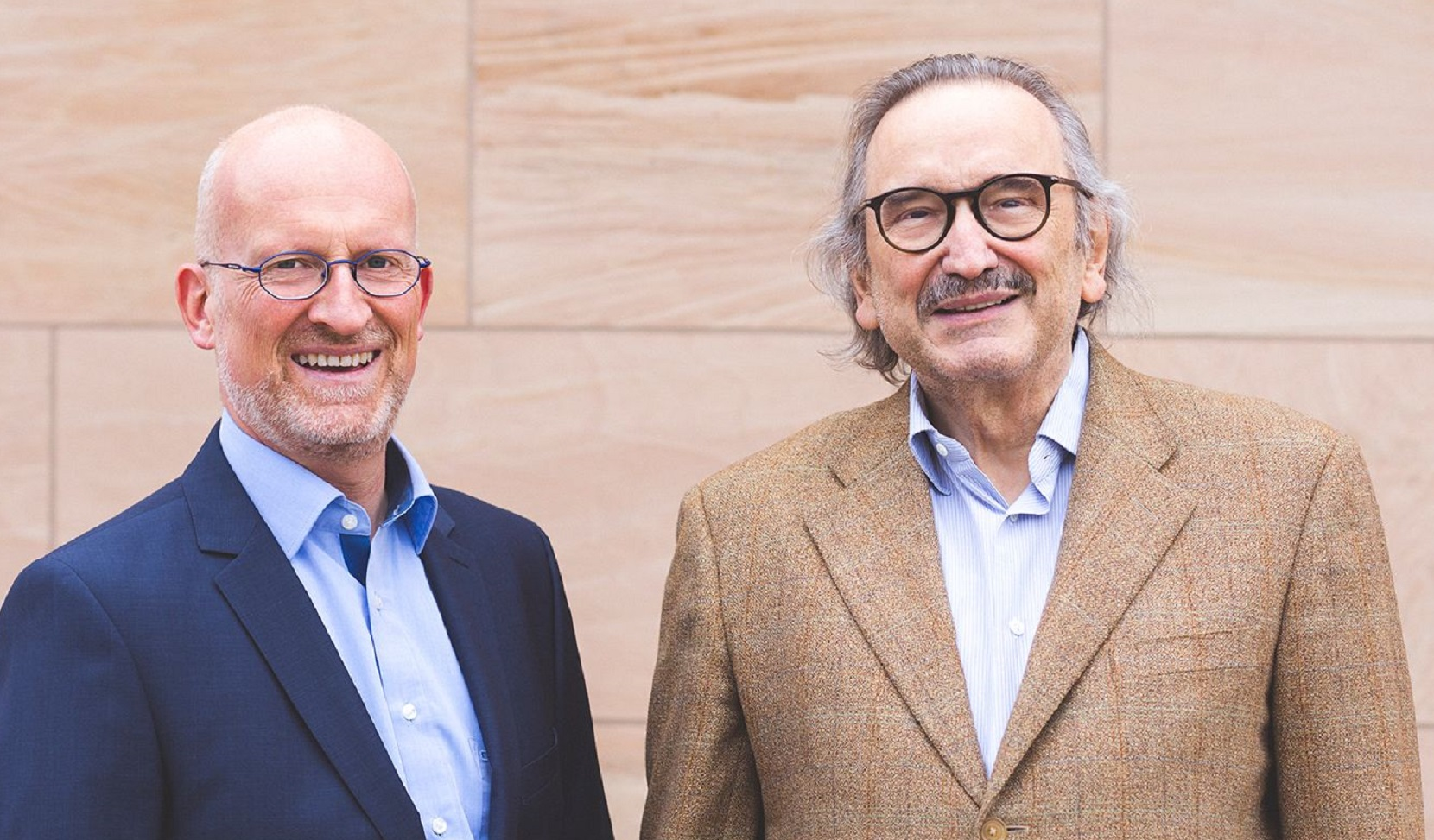 Dr. Reimar Schlingensiepen (left), the newly appointed CEO of AudioCure Pharma GmbH, takes over from Prof. Hans Rommelspacher, founder of the company, who continues as CSO.